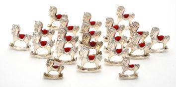 Twenty silver mounted rocking horse pin cushions