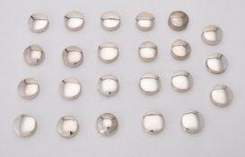 A collection of silver circular pill boxes