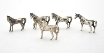Four silver models of horses