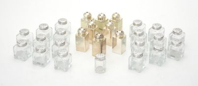 Four pairs of silver salt and pepper shakers