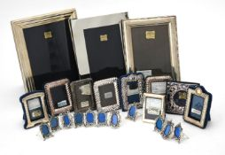 A collection of silver mounted photo frames