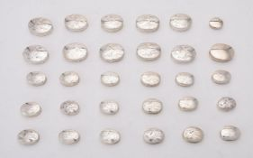 A collection of silver oval boxes