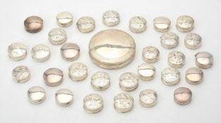 A collection of silver circular boxes