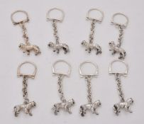 Eight silver tiger key rings