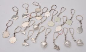 A collection of silver key rings