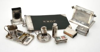 A collection of silver mounted desk items