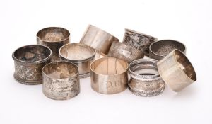 A collection of eleven silver napkin rings