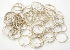 A quantity of silver coloured christening bangles