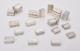 A collection of silver and silver coloured book shaped boxes