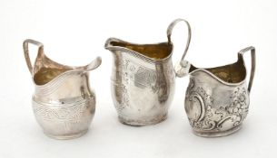A George III silver oval baluster cream jug by Samuel & Edward Davenport