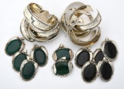 A collection of silver and silver coloured bangles and stone pendants