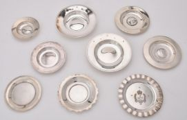 A collection of silver circular dishes