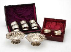 A pair of Edwardian silver shaped circular dishes by Colen Hewer Cheshire