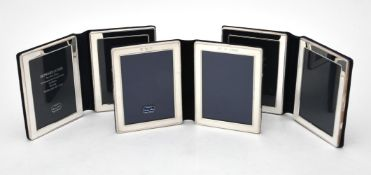 Three silver mounted folding double photo frames by Kitney & Co.