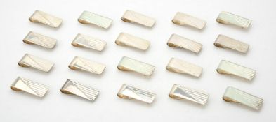 A collection of silver rectangular money clips