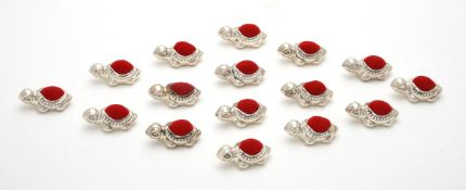 A collection of sixteen silver mounted turtle pin cushions