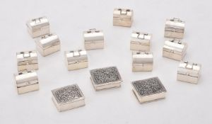 A collection of silver pill boxes