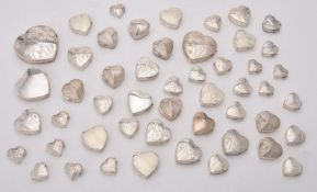 A collection of silver heart shaped boxes