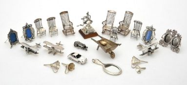 A collection of silver and silver coloured miniature models