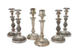 A set of four electro-plated candle sticks