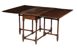 A chestnut, fruitwood and oak gate leg table
