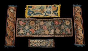 A collection of various verdure tapestry and other tapestry cushions and fragments