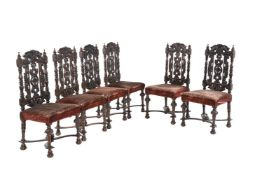 A set of six Victorian stained and carved oak dining chairs in Carrollian style