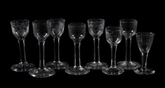 Eight various engraved plain-stemmed wine glasses