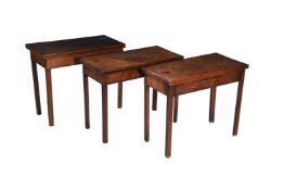 A group of three similar George III mahogany folding tables