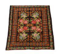 A floral flatweave rug