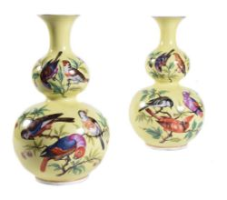 A pair of Dresden yellow ground double gourd vases painted with various birds