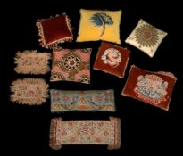 A collection of various tapestry cushions