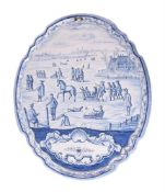 A large Dutch Delft blue and white shaped oval plaque