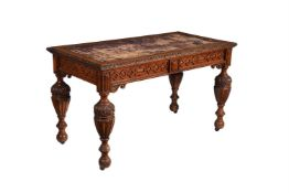 A Victorian carved oak writing table