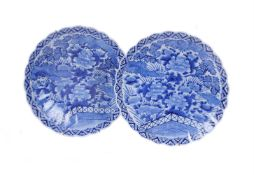A pair of Arita porcelain blue and white fluted chargers with scalloped rims