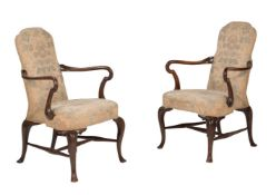 A pair of walnut and beech armchairs in George I style