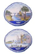 A pair of Dutch Delft polychrome shaped oval horizontal wall-plaques