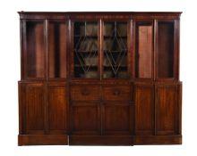 Y A mahogany and ebony inlaid breakfront bookcase