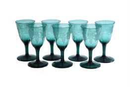 Seven green and engraved plain-stemmed wine glasses