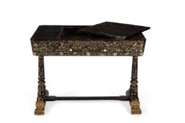 A Chinese Export black lacquered and parcel gilt and floral painted games table