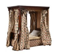 A late Victorian or Edwardian mahogany model of a four poster bed