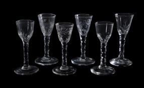 A group of six facet-stemmed wine glasses