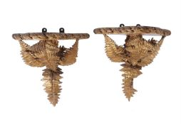 A pair of gilt wood and composition wall brackets in 18th century taste