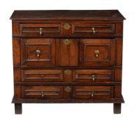 A Charles II oak chest of drawers