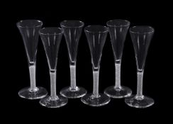 Six similar opaque-twist wine flutes