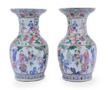 A pair of Cantonese Famille Rose vases