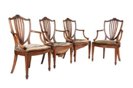 A set of four oak and upholstered armchairs in George III style