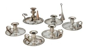 A set of four electro-plated circular chambersticks by Elkington & Co.
