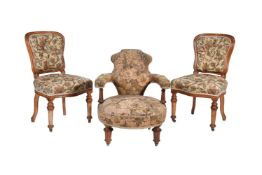A Victorian walnut and upholstered low armchair