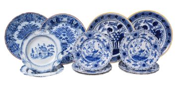 An assortment of mostly Dutch Delft blue and white plates and chargers
